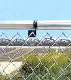 A roller on the top of a fence will help prevent a coyote from scrambling over.