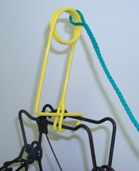Conibear safety tool to set trap.