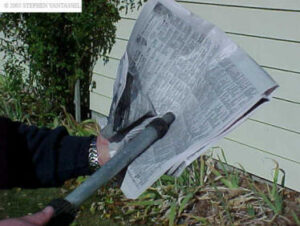 Newspaper sheets near end of pole.